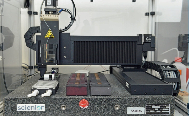 Automated glycan array printer for disease diagnosis: The instrument coats glass chips with thousands of sugar molecules from pathogens.